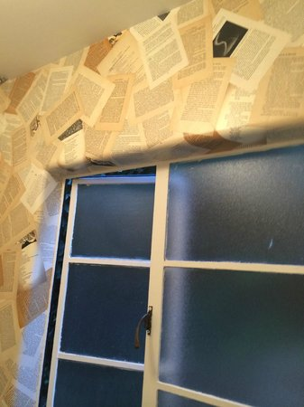 Vagabond's House Inn: Real pages of books make cool wallpaper