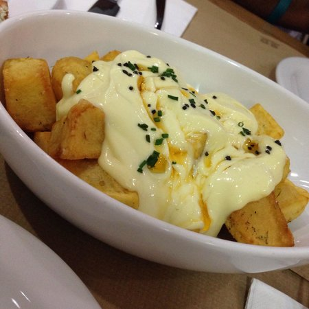 TocaTeca: Potatoes with Barcelona's special sauce they said. Totally yum and quite filling