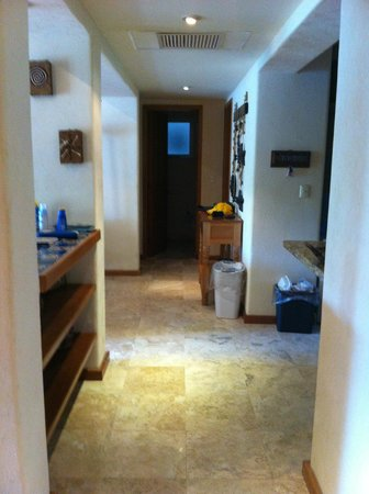 Chac Hal Al Condominiums: Kitchen's on the right, living/dining on left in H-102. Looking towards rooms.