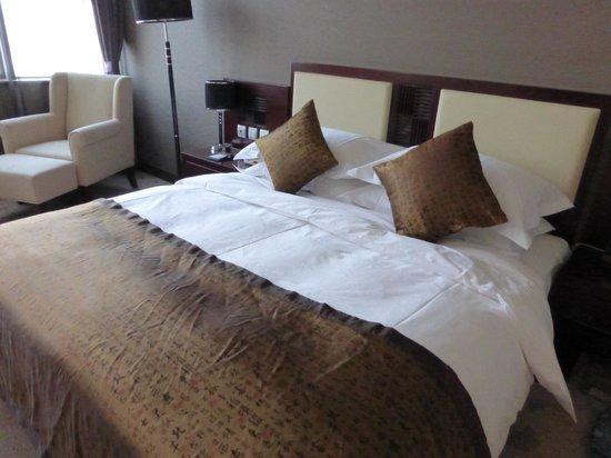 Wenhui Hotel: bed