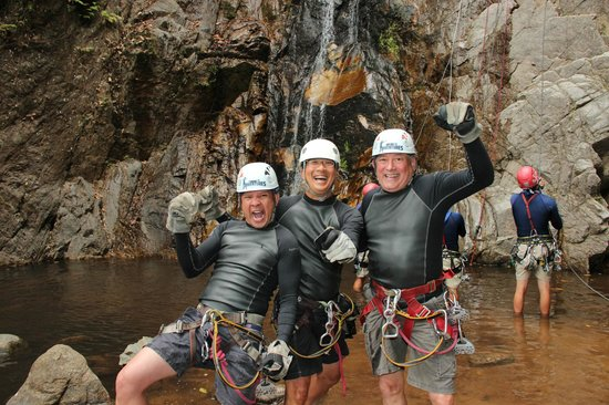 Outdoor Adventure by Vallarta Adventures: 3 Amigos conquer rappelling dow the waterfall.