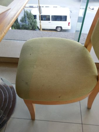 Royale Chulan Bukit Bintang : even chairs in dinning room stained