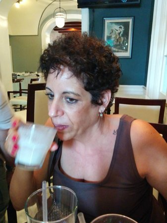 Drink & Learn: My sister in law sampling the Ramos Gin Fizz!  It was awesome!!!