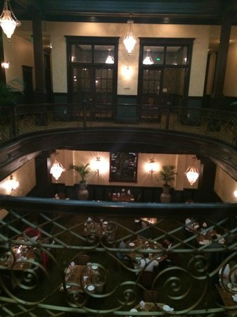 Geiser Grand Hotel: original wrought iron on second floor opne to dining area with library