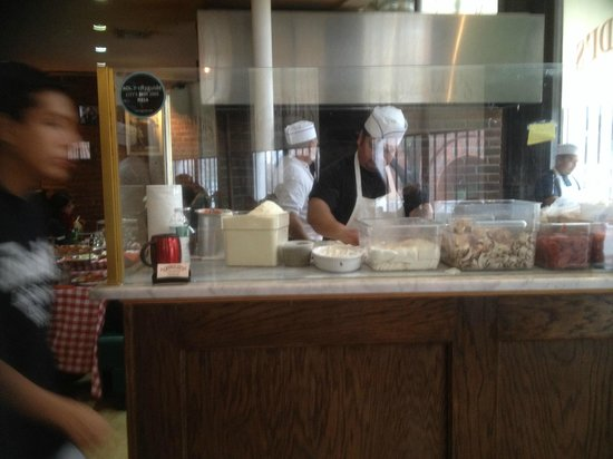 Grimaldi's Pizzeria: Watch the pizzas being made.