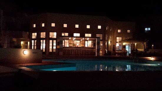 Galaxy Villas: pool and reception by night