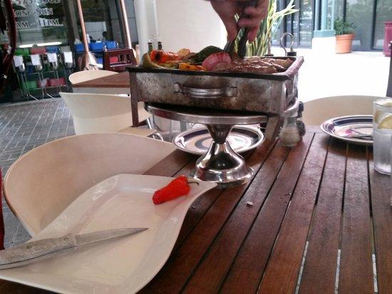 La Fontana Pizzeria & Italian Restaurant: Grigliata di carne delivered to the table still on the grill