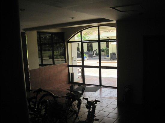 Riverside Serviced Apartments: building entrance  - opposite  the building I got a mini market