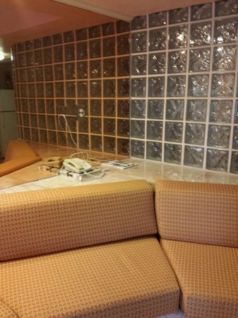 Taino Beach Resort & Clubs: the sparsely furnished room is cavernous enough without the mirrors on all the walls.