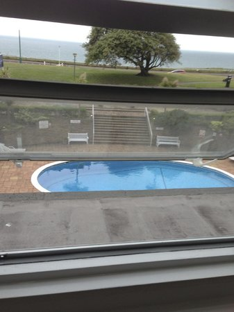 The Ocean View Hotel: View of pool from dining room