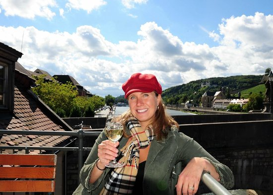 Enjoying a Silvaner white wine on the Alte Mainmuhle deck
