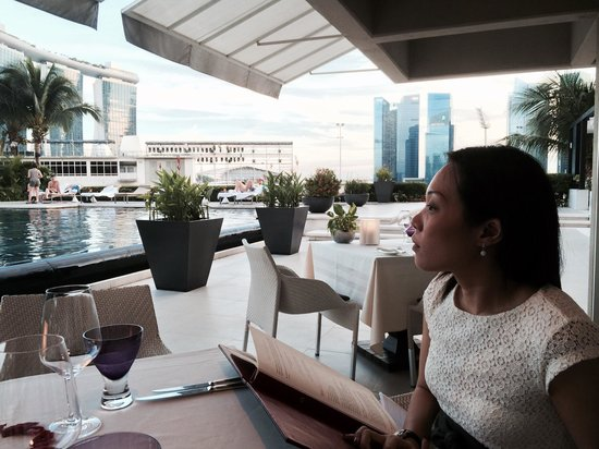 Dolce Vita at Mandarin Oriental: My wife enjoying the scenery beside the pool