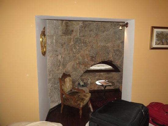 Hotel Peristil: Piece of the wall of Diocletian's Palace in our room on the top floor