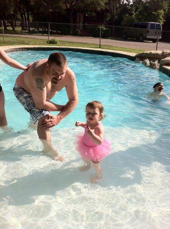 Canyon Lake Cabins & Cottages: My brother and niece! Perfect pool area for all!
