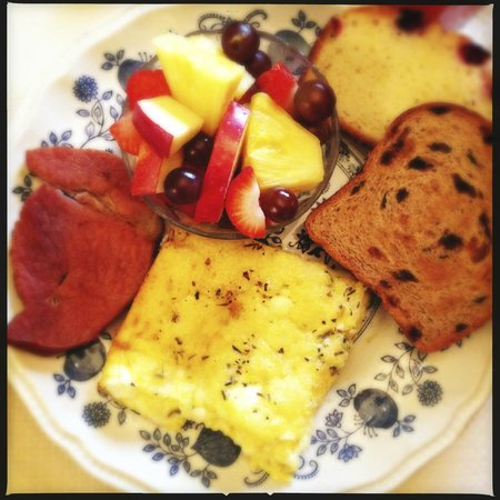Colonial Pines Inn Bed and Breakfast : Close up of breakfast caserole, ham, breads and fruit.