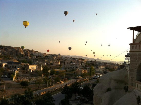 Hotballons floating near SOS Cave hotel in morning