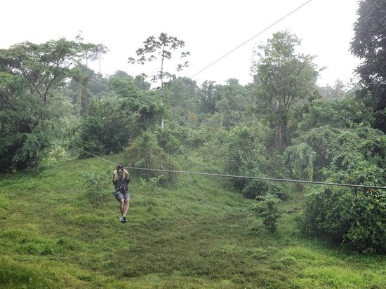 Terraventuras Travel & Expeditions: My boyfriend coming in on the last zip line.