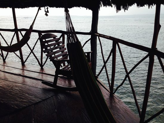 Yandup Island Lodge: Hammocks and rocking chair on porch