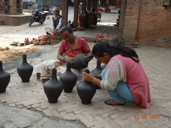 Pottery Square: Women finishing off some pots