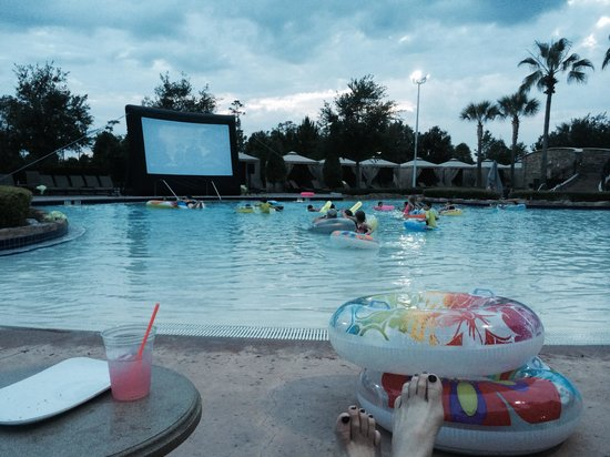 Hilton Orlando Bonnet Creek: Movie at dusk as we sit in our lounge chairs poolside