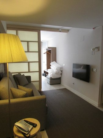 Eric Vokel Boutique Apartments - Atocha Suites: looking from lounge into bedroom