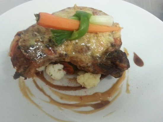 The Brunswick: Smoked pork chop with a blue cheese sauce served with seasonal veg and a choice of either hand c