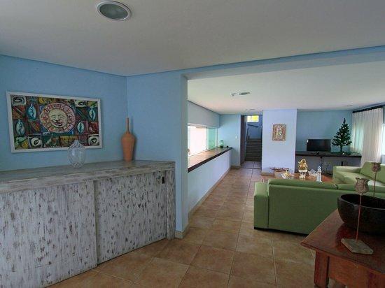 Farol de Itapua Praia Hotel: Sala de TV