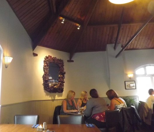 Signals Bistro: Ornate mirror hangs on the wall