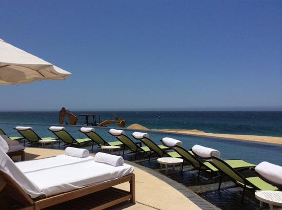 The Resort at Pedregal: Caterpillar backhoe on the beach