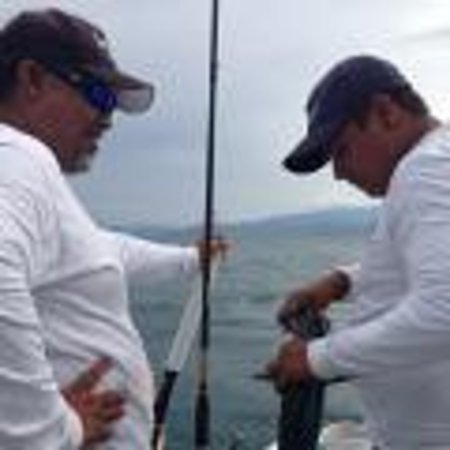Julio's Tour & Fishing Guide Services: Julio, Tomas, and Fish