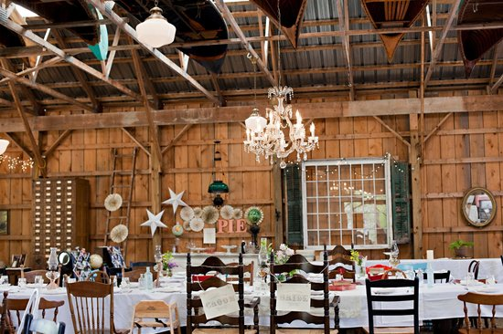 Fiddle Lake Farm: Vintage canoes and a chandelier in the rafters of the main barn