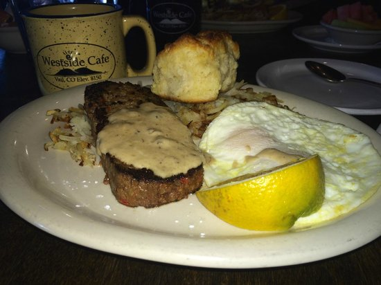 Westside Cafe & Market: My bison meatloaf with eggs over easy and hash browns plus biscuit.