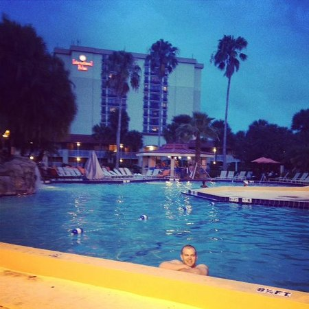 International Palms Resort & Conference Center: view of the tower and pool at dusk
