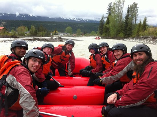 Alpine Rafting: happy group finishing the float through golden