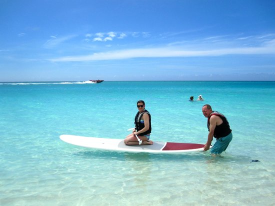 Sands at Grace Bay : Attempting the paddle board.