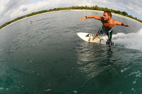 Surfcamp - Palm Beach Krui: My friend Guzman having fun in Krui Left