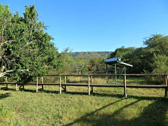 Ruzizi Tented Lodge: One of the walkways linking the tented huts, with a solar panel
