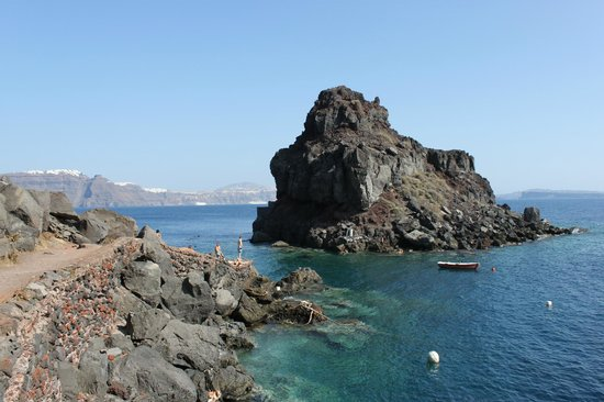 Amoudi Bay : The Island of love. There is a Chappel on the other side, you neet to swim to it.