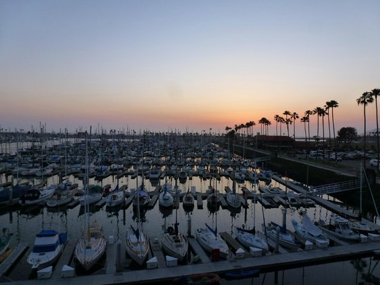 Holiday Inn Express Hotel & Suites Ventura Harbor: Sunset over the marina from our room 357
