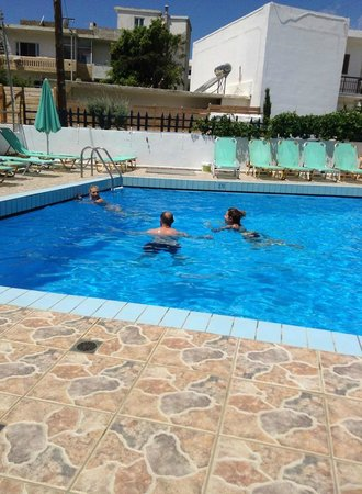 Costas & Chrysoula: family in pool,when it work,
