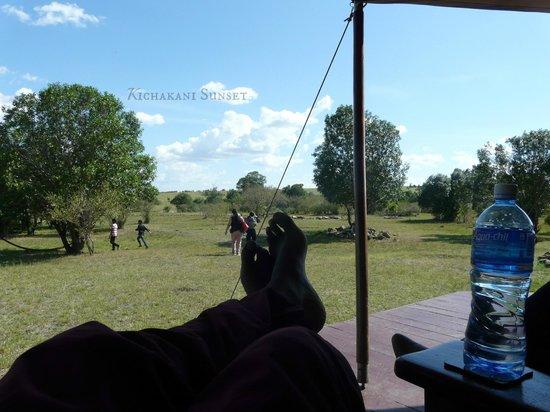 Loyk Mara Luxury Camp: view from verandah with wildebeest