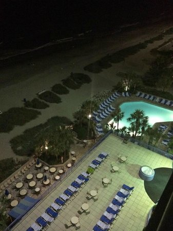Coral Beach Resort & Suites: Late night photo of eatery/outdoor bar, and decks
