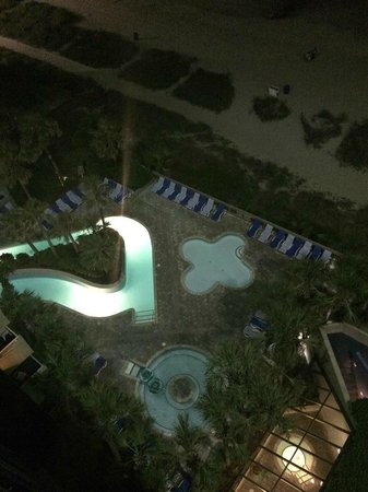 Coral Beach Resort & Suites: Late night photo of one of the pool areas from our balcony