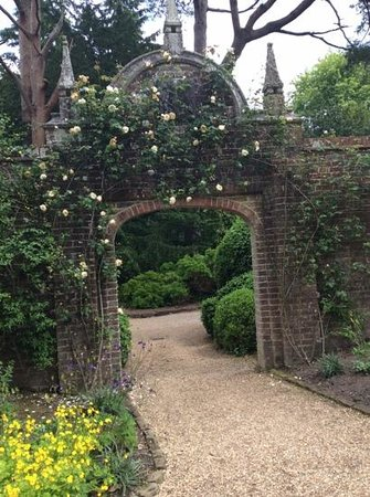 Nymans Gardens and House: Scented roses over an interesting archway
