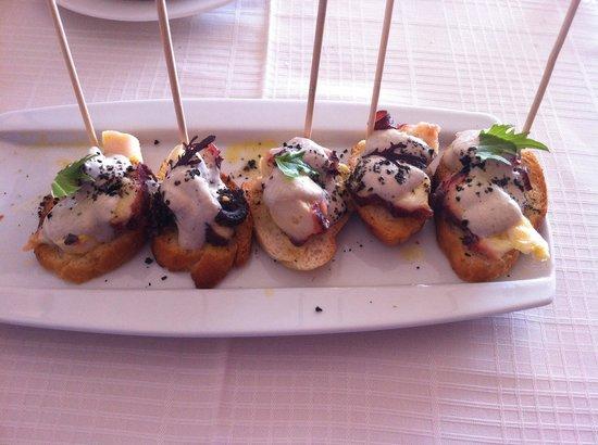 Portofino: Pulpo con salsa de aceitunas