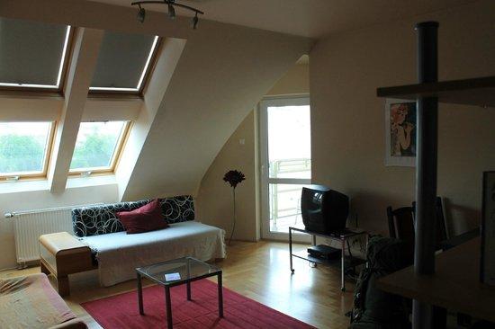 InnerCity Apartments: living room abd balcony