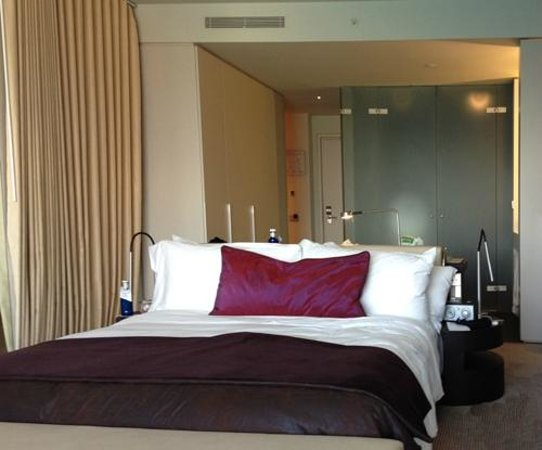 W Barcelona: Bed with view of bathroom behind it