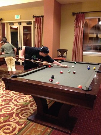 Wyndham Grand Orlando Resort Bonnet Creek: My son playing pool in the Activity center