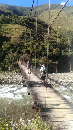 Lorenzo Expeditions: Day 2: Crossing the river on a rickety old bridge