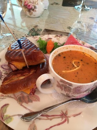 Simply Scrumptious Tea Room and Emporium : Hot ham & cheese on a pretzel roll with a cup of tomato basil.